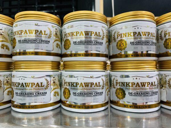 Stacked jars of PinkPawPal De-Greasing Cream